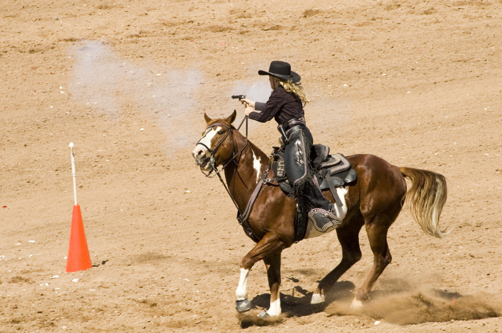 mounted shooting action at the Arizona Cowboy Mounted Shooting Association 2007 southwest regional championship in Phoenix.